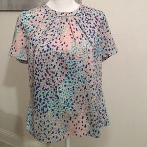Pastel multi-colored short sleeve top.